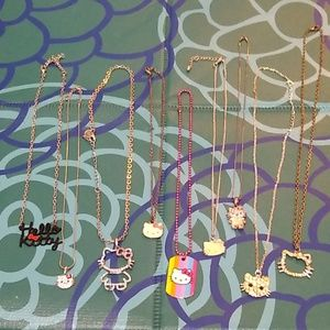 9 Hello Kitty necklaces. Fair condition